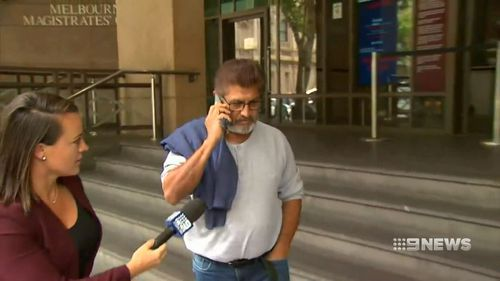 The accused's father was silent outside court today.