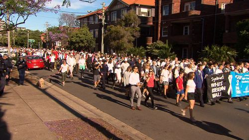 Thousands of walkers took to the streets of Coogee this morning for the White Ribbon march to raise further awareness about domestic violence.