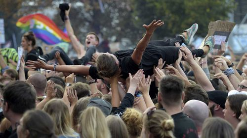 Crowdsurfers revel during an anti-racism concert in Chemnitz held on Monday.