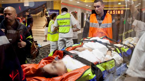 A victim is rushed to hospital after a gunman drove a truck into a crowd at Bastille Day celebrations in Nice. (Getty)
