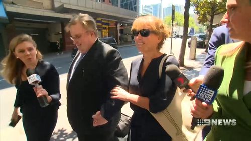 UTS Dean of Science Dianne Jolley leaves court with her lawyer after pleading not guilty to all charges relating to allegations she conducted a fake harassment campaign against herself.