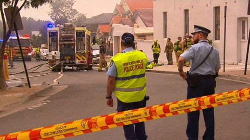 Emergency services responding to a building fire in Sydney's inner west.