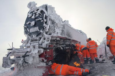 <p>Germany: A team works to de-ice a classic locomotive</p> <p> </p>