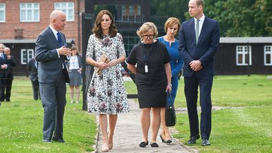 Catherine, Duchess of Cambridge, and Prince William walk with Piotr Tarnowski, the director of the Stutthof Museum, during a visit to the Former Nazi-German Concentration Camp KL Stutthof in Sztutowo village, northern Poland. (AAP)