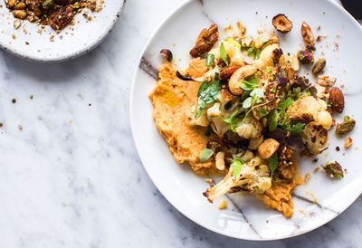 Roast cauliflower, sweet potato hummus and spice nut crumble salad