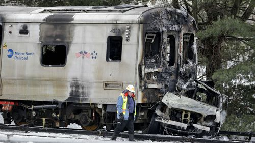 Six dead after packed commuter train crashes into car in New York