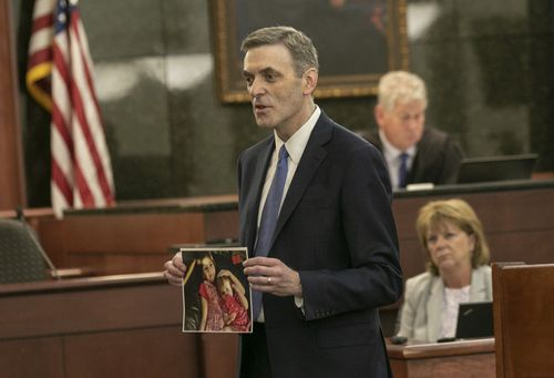 11th Circuit Solicitor Rick Hubbard delivers closing arguments, showing pictures of the Jones children during the sentencing phase of the trial of Timothy Jones Jr. (Tracy Glantz/The State via AP, Pool)