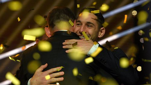 Smith is congratulated by team mate Billy Slater. (AAP)