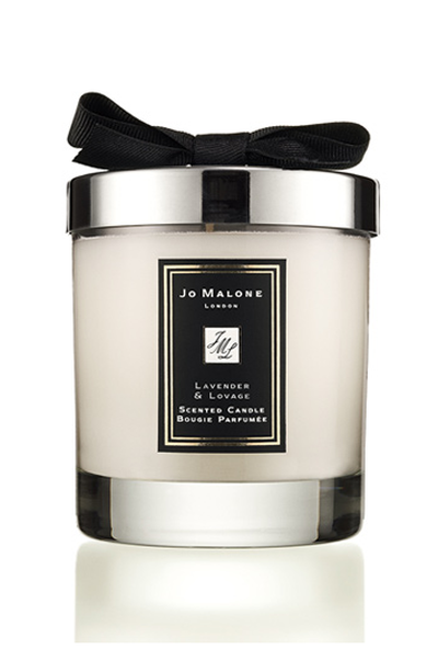 """<a href=""""https://www.jomalone.com.au/product/3560/29550/for-the-home/home-candles/lavender-lovage-home-candle"""" target=""""_blank"""" draggable=""""false"""">Jo Malone London Lavender & Lovage Home Candle, $88.00</a>."""