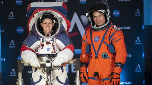The two NASA spacesuit prototypes for lunar exploration, one for launch and re-entry aboard the agency's Orion spacecraft, known as the Orion Crew Survival Suit, is worn by Dustin Gohmert, right, and one for exploring the surface of the Moon's South Pole, known as the Exploration Extravehicular Mobility Unit (xEMU) is worn by Kristine Dans.
