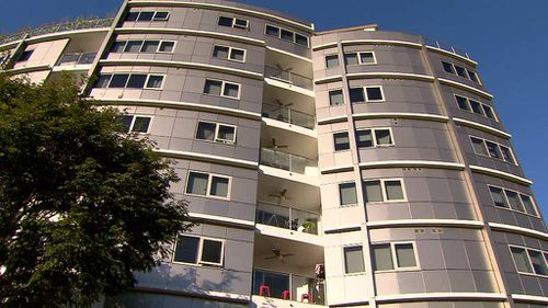 He fell 30m from the balcony on Upper Roma St. (9NEWS)