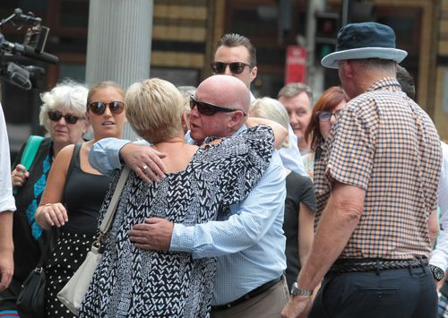 The family of Ms McGrath embrace outside Downing Centre Local Court before Grice's sentencing this afternoon. (AAP)