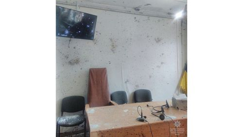 The courtroom can be seen covered in shrapnel. (Image: Ukrainian Police Facebook)