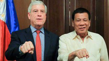 Nick Warner with President Rodrigo Duterte. (Supplied)