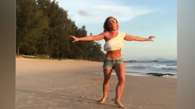 Britney Spears runs, dances, and does a bikini-clad cartwheel in Thailand: Watch!