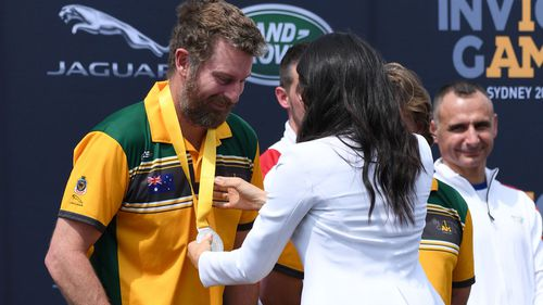 Earlier in the day Meghan Markle awarded her first Invictus Games medal to Australia in the driving challenge