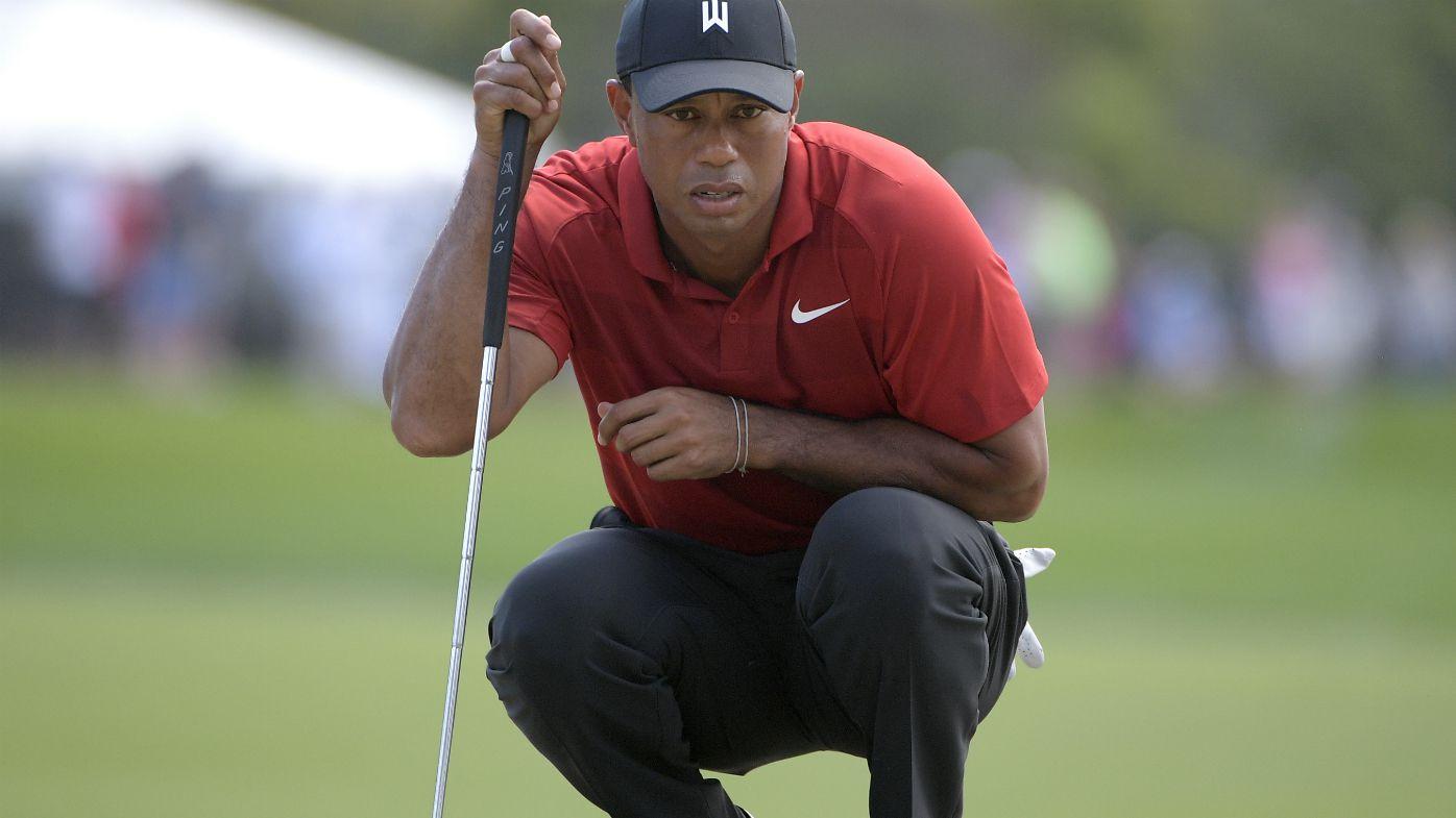 Tiger Woods watches putt