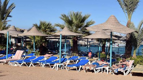 A file photo taken on January 9, 2016 shows tourists relaxing on the beach at the Bella Vista Hotel in Egypt's Red Sea resort of Hurghada. (AFP)