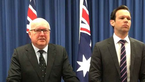 George Brandis and Matt Canavan front the media today. (AAP)