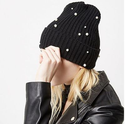 "<p>Top hat</p> <p><a href=""https://au.riverisland.com/women/sale/accessories/black-knit-pearl-beanie-693872"" target=""_blank"" draggable=""false""><strong>River Island</strong></a> Pearl Beanie $14</p>"