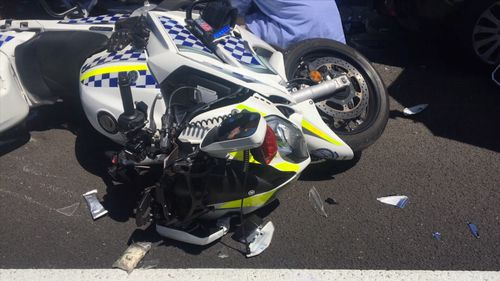 The officer was at his motorcycle when a passing Mazda rammed into him and also hit the Subaru he had pulled over.