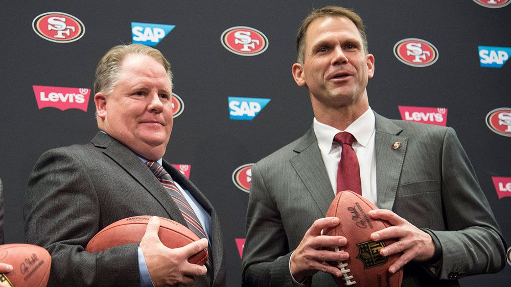 Chip Kelly and Trent Baalke. (AAP)