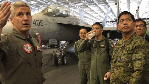 Rear Admiral Steve Koehler, commander CSG-9 of the U.S. aircraft carrier Theodore Roosevelt, briefs top Philippine generals.