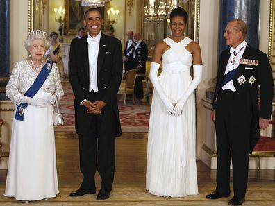 President Barack Obama, first lady Michelle Obama, Queen Elizabeth II, and Prince Philip pose for photographers prior to a dinner hosted by the queen at Buckingham Palace