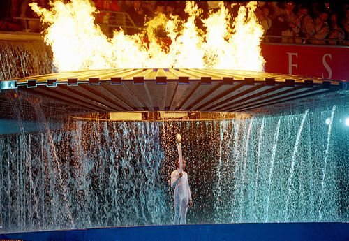 15 Sep 2000:  The Cauldron containing the Olympic Flame rises above Torch Bearer Cathy Freeman of Australia during the Opening Ceremony of the Sydney 2000 Olympic Games at the Olympic Stadium in Homebush Bay, Sydney, Australia. \ Mandatory Credit: Billy Stickland /Allsport