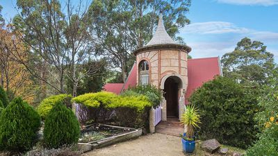 This enchanted home has a Camelot tower and secret staircase