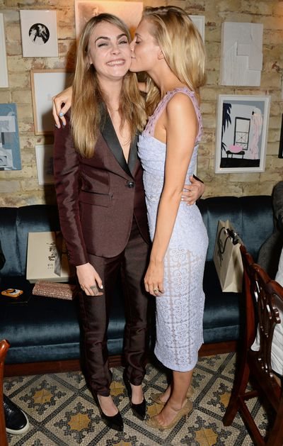 Models and actresses who share careers and laughter. Cara and Poppy Delevingne.