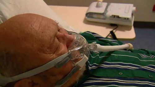 David Cahoon with a CPAP machine. (9NEWS)