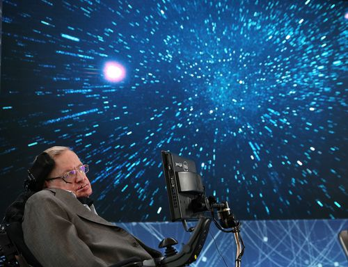 "Professor Hawking on stage during the New Space Exploration Initiative's ""Breakthrough Starshot"" announcement at One World Observatory in New York City in 2016. (Jemal Countess/Getty Images)"