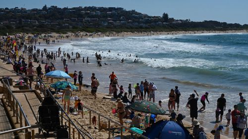 Authorities have reminded people to maintain social distancing while enjoying the long weekend. Pictured is Dee Why Beach.