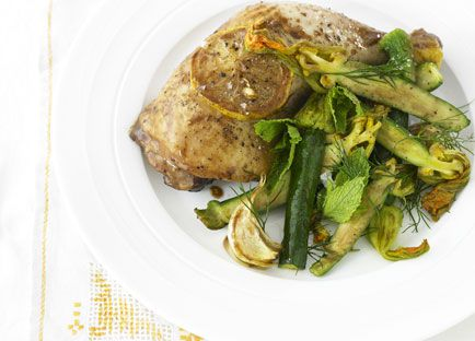 Roast lemon chicken with warm zucchini flower salad