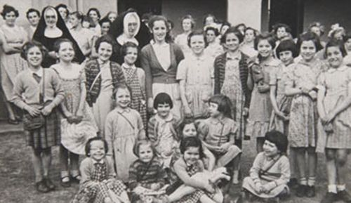 Yvonne Radzevicius, standing third from left in a picture loaned to the On Their Own project. After WW2, over 3000 children young as three were sent to Australia.