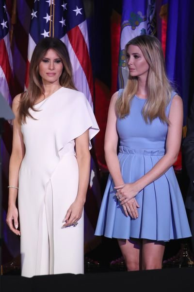 Melania Trump in a white Ralph Lauren jumpsuit with stepdaughter Ivanka Trump.