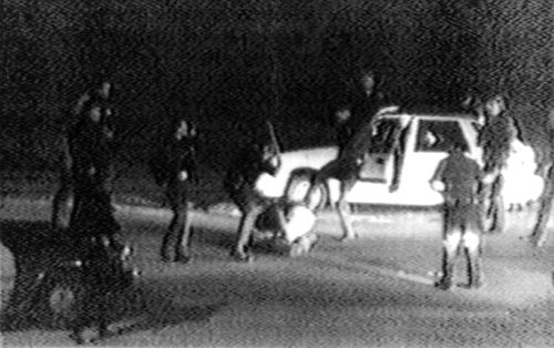 Image made from video shot by George Holliday shows police officers beating a man, later identified as Rodney King. King, the black motorist whose 1991 videotaped beating by Los Angeles police officers was the touchstone for one of the most destructive race riots in the nation's history, died in 2012.