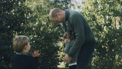 Prince William tickling Princess Charlotte as Prince Louis screams with joy