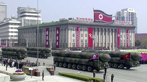 Missiles are displayed during a parade at Kim Il-Sung Square.