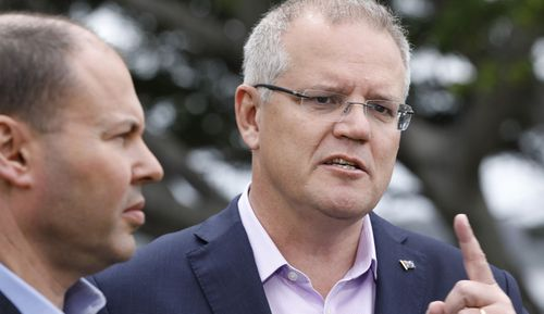 Federal Treasurer Josh Frydenberg (left) and Prime Minister Scott Morrison have something to smile about.