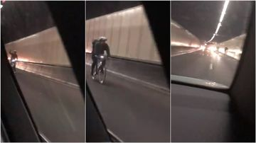 A cyclist was filmed riding down Sydney's busy M5 Motorway, holding up traffic yesterday.