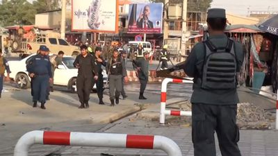 Blast in Afghanistan's Kabul kills 14, returning VP unharmed