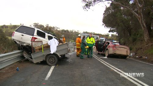 The ute ended up balanced precariously on the guard rail. Picture: 9NEWS