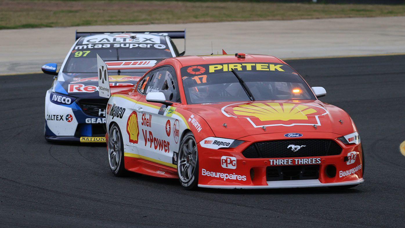 Scott McLaughlin held off Shane van Gisbergen at Sydney Motorsport Park.