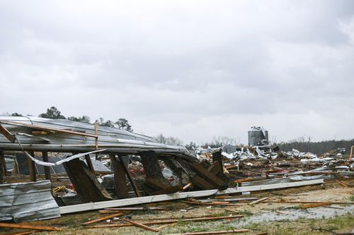 A chicken farm in Wayne County, Mississippi , sustained extensive damage on St. Patrick's Day after severe weather came through the area, Forecasters believe more severe weather is expected. (Cam Bonelli/Hattiesburg American via AP)