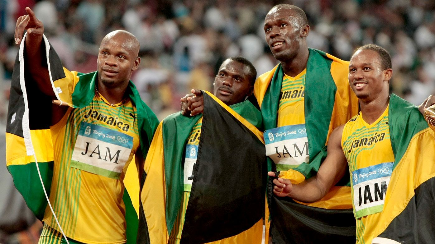 Asafa Powell, Nesta Carter, Usain Bolt and Michael Frater celebrate after winning the men's 4x100m relay at the Beijing Olympics in 2008. (AAP)