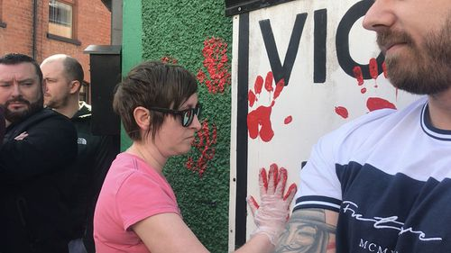 Friends of murdered journalist Lyra McKee defaced the walls of a dissident republican office in Derry with red paint.