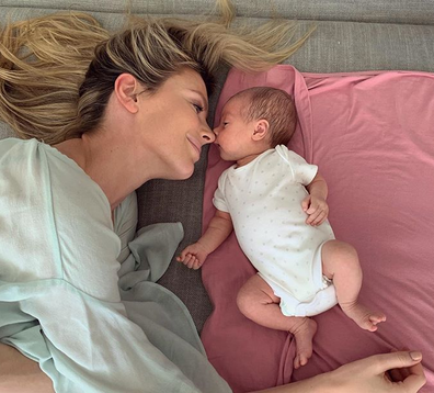 Jennifer Hawkins with her daughter Frankie lying down