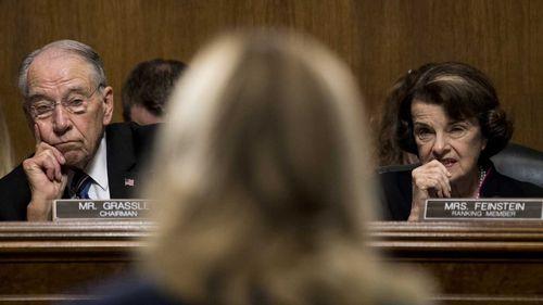 Republican Judiciary Committee chairman Senator Chuck Grassley and Democratic ranking member Senator Dianne Feinstein listen to Dr Christine Blasey Ford's testimony.